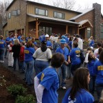 Group gathered outside of new home construction done by custom home builders Hedrick Creative Building, LLC in Lexington, NC