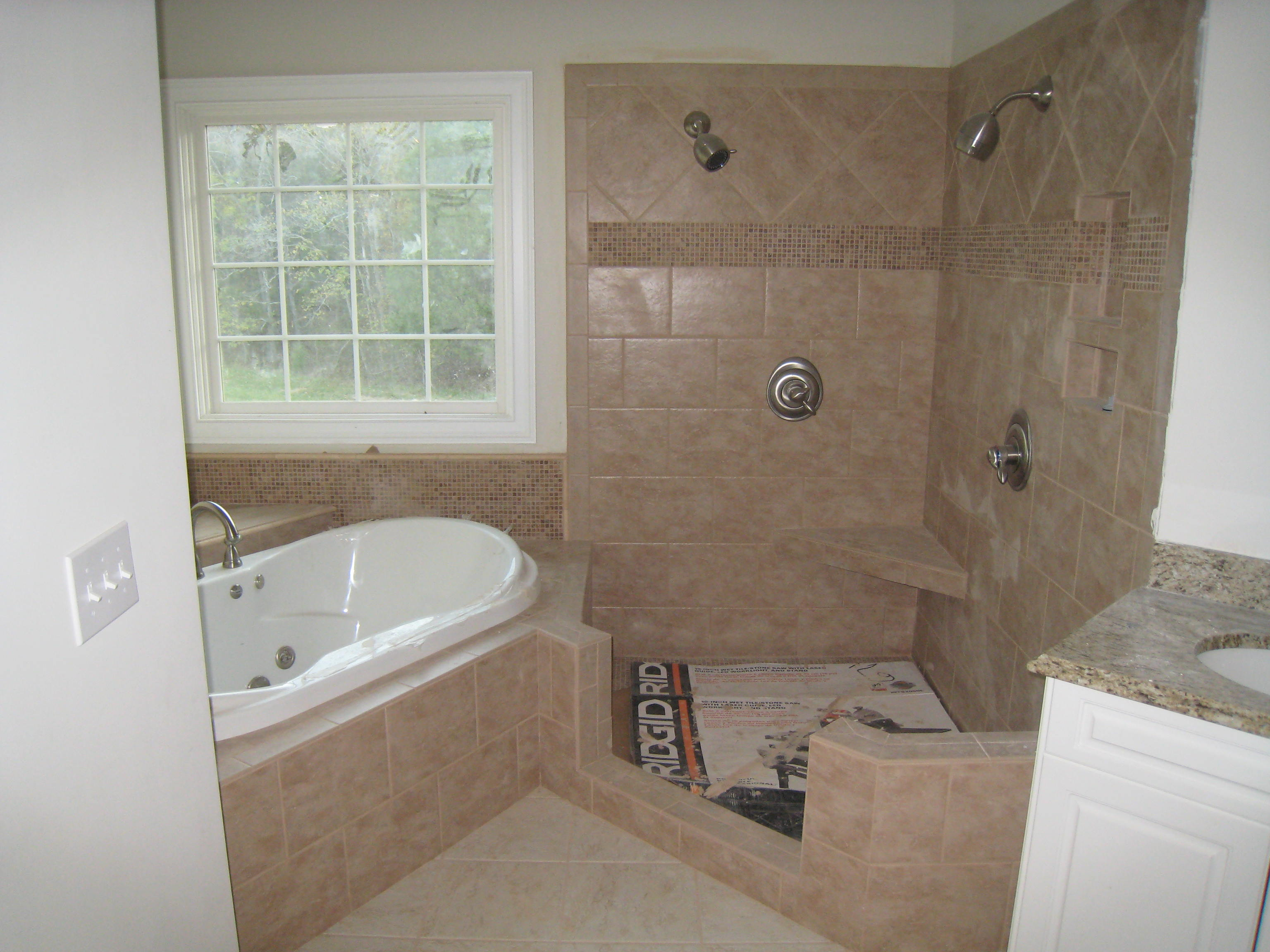 Custom bathtub and shower installations finished by home remodeling company Hedrick Creative Building, LLC in Lexington, NC
