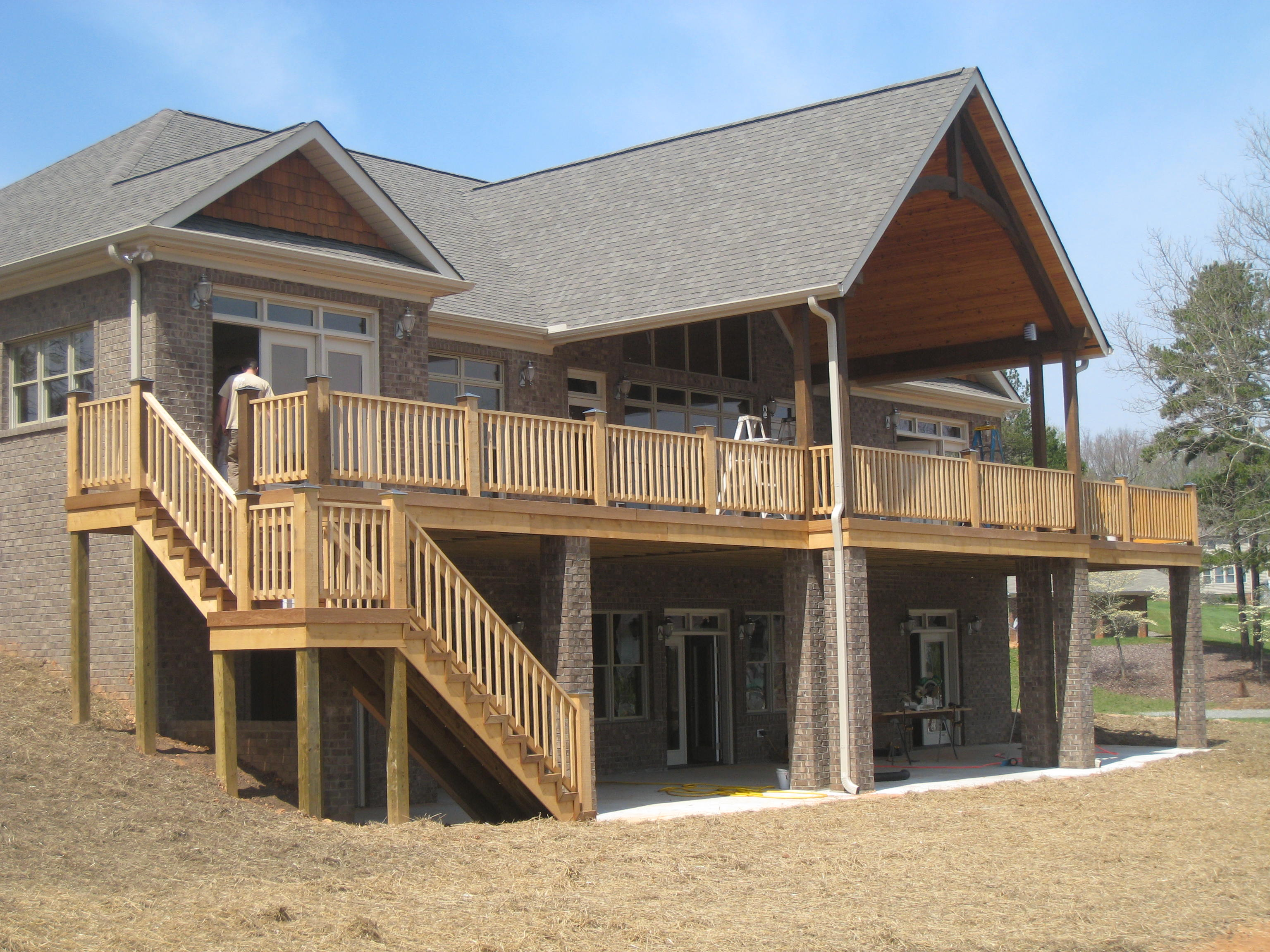 New home with custom porch designed by custom home builders Hedrick Creative Building, LLC in Lexington, NC
